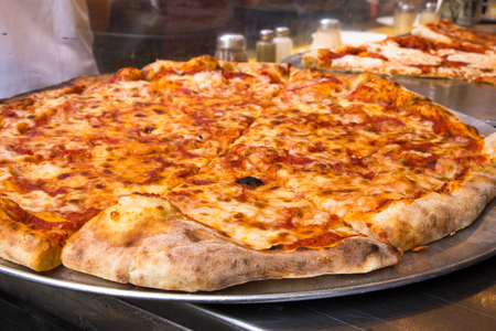 Authentic New York City Italian style pizzeria pizza pie Archivio Fotografico