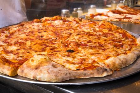 Authentic New York City Italian style pizzeria pizza pie Standard-Bild