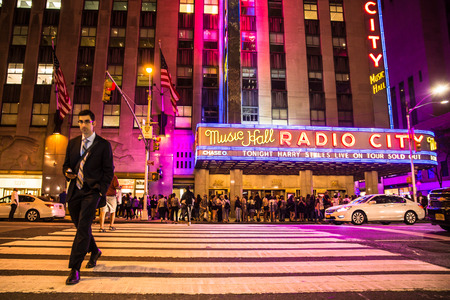 NEW YORK CITY - SEPTEMBER 28, 2017: View of busy night street scene outside Radio City Music Hall on Sixth Avenue in Midtown Manhattan.