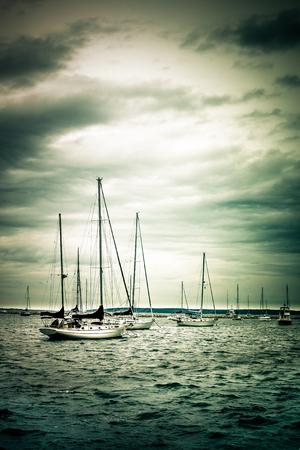 Sailboats under dramatic clouds Banco de Imagens