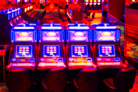 Defocused blur of gambling slot machines in casino Stock Photo