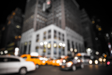 Defocus blur of New York City street scene at night with lights, cars,  yellow taxi cabs and buildings Stock fotó