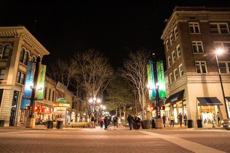 BOULDER, COLORADO - APRIL 27, 2018: Night scene along popular Pearl Street Mall with people and lights in downtown Boulder Colorado Editorial