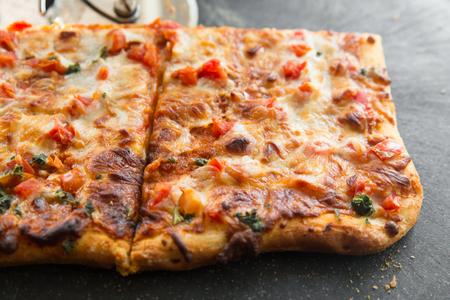Fresh delicious Pizza cut into squares Standard-Bild