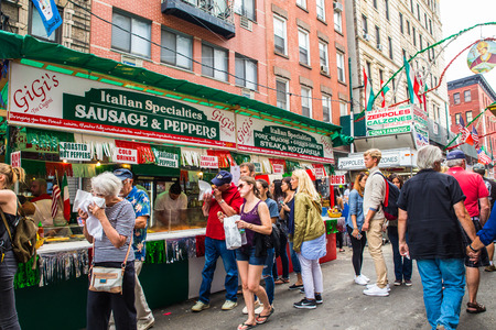 NEW YORK CITY - SEPTEMBER 21, 2017:  View of the Annual Feast of San Gennaro street festival on the street of Little Italy in Manhattan with food vendors, decorations and real people in view.