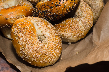 Variety of fresh authentic New York Style Bagels with seeds Stock fotó