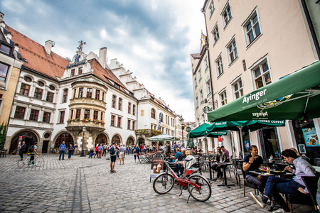 MUNICH, GERMANY - SEPTEMBER 13, 2018:  Street scene outside the historic Haufbrauhaus in Munich Germany with restaurants and people. Editöryel