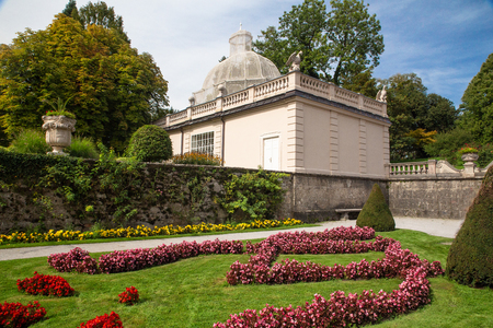 View from beautiful Mirabelle Gardens and Palace in Salzburg Austria on a sunny day.