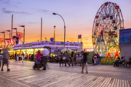 oney Island boardwalk in Brooklyn with amusement park rides