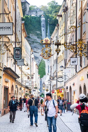 SALZBURG, AUSTRIA - SEPTEMBER 11, 2018:  Street scene from the city of Salzburg Austria in popular tourist shopping district with people visible