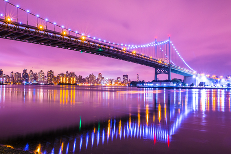 View of RFK Triborough Bridge from Astoria Queens towards Roosevelt Island and Manhattan New York City seen at night