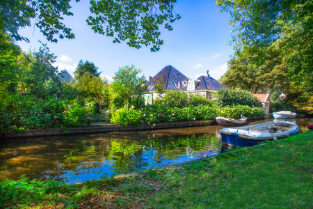 Scenic Holland canal scene from Broek in Waterland in the Netherlands