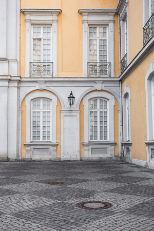 Architectural Details on classical styled building with yellow and white trim