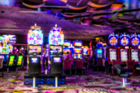 Colorful defocused blur of casino with slot machines Фото со стока