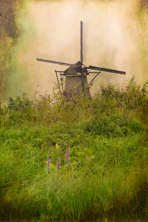 Traditional Dutch windmill with grunge vintage texture Imagens