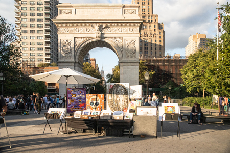 NEW YORK CITY, NY - AUGUST 24, 2019:  Scene from Washington Square Park in Greenwich Village, Manhattan on a summer afternoon.