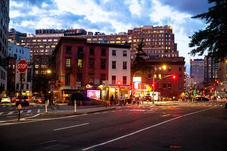 NEW YORK CITY - AUGUST 24, 2019: Street scene with stores, lights, people and cars, at night seen from Greenwich Village, West Village Manhattan. Stockfoto - 131903801