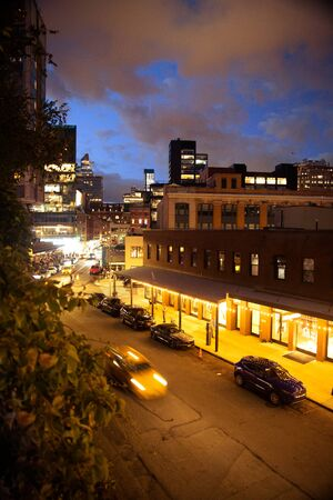 NEW YORK CITY - AUGUST 24, 2019: View from above of city street in the Meatpacking District from Manhattan seen at night with lights.