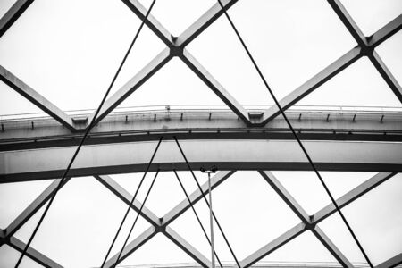 Structure of steel beams and cables in black and white