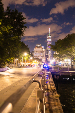NEW YORK CITY - AUGUST 24, 2019:  View of the skyline of lower Manhattan looking towards the World Trade Center Tower at night with lights seen from dock Redactioneel