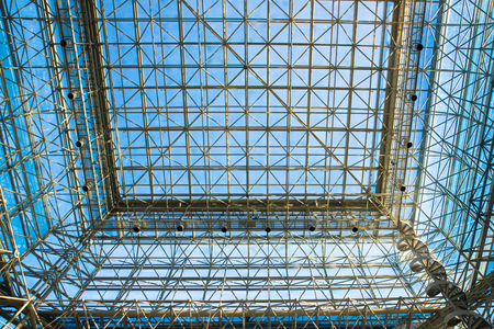 abstract metal and glass ceiling in modern building