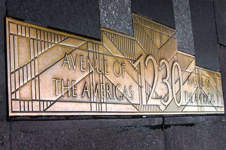 NEW YORK CITY - OCTOBER 24, 2019: Historic sidewalk plaque at 1230 Avenue of Americas in New York City