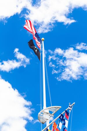 WANTAGH, NEW YORK - MAY 24, 2019: View of flagpole with American, POW and marine flags in the central mall at Jones Beach State Park.