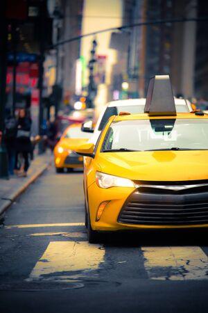 New York City Street scene with iconic yellow taxi cab
