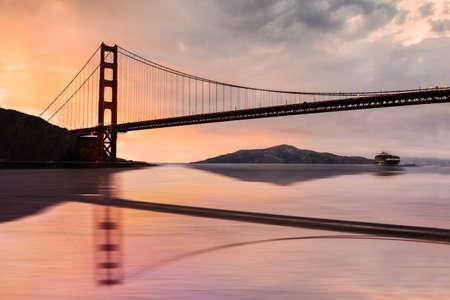Beautiful Golden Gate Bridge over San Francisco Bay at sunset