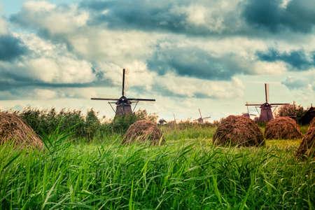Beautiful Dutch windmills and landscape under dramatic sky