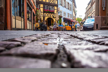 Strasbourg, France - September 7, 2018:  Low angle perspective with cobblestone street from old city of Strasbourg France Redactioneel