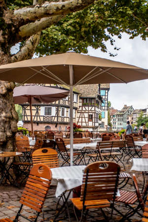Strasbourg, France - September 7m 2018:  Outdoor dining with table and chairs seen from the old city of Strasbourg France