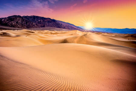 Beautiful sand dunes landscape seen at Death Valley National Park, California at sunset