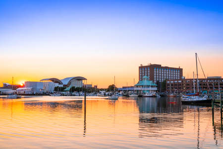 View of Hampton Virginia downtown waterfront district seen at sunset under colorful sky Editorial