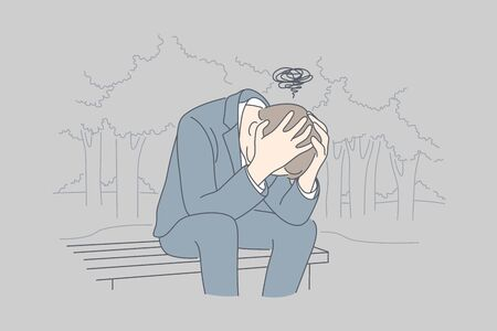 Despair, frustration, depression, business concept. Desperate young businessman crying in his hands sitting on bench covering head. Fatigue headache or migraine bad news and raising of mental stress.