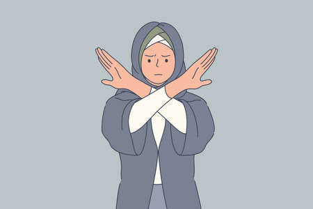 Emotion, face, rejection, prohibition, denial concept. Young angry sad serious arab muslim woman with hidjab crossing arms denying proposal. Stop gesture and negative facial expression illustration.