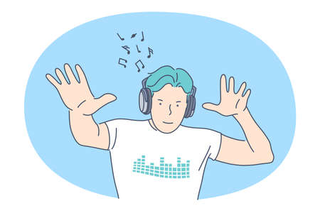 Listening to Music, recreation concept. Smiling man in headphones listening to favourite music and dancing with rhythm. Music lover, melody, song, hobby