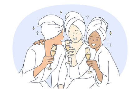 Bride and friends party, pajama party with friends concept. Young smiling multiethnic girls with glasses of champagne in towels and home clothing having fun and celebrating holiday together