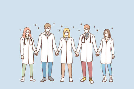 Doctors teamwork, uniting efforts against pandemic concept. Group of young doctors in protective medical face masks standing and holding hands in team during pandemic vector illustration