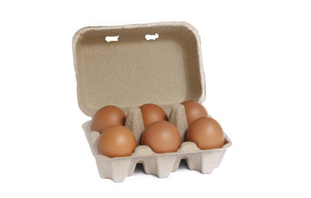 egg box: egg box with six brown eggs isolated