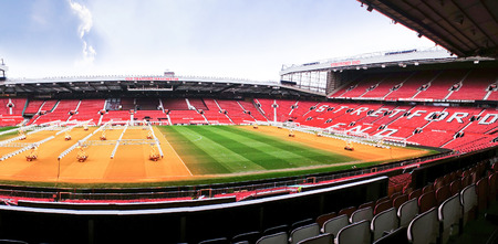 MANCHESTER ENGLAND  FEBRUARY 17: Old Trafford stadium on February 17 2014 in Manchester England. Old Trafford stadium is home to Manchester United.
