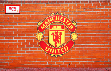 MANCHESTER ENGLAND  FEBRUARY 17 2014: Logo on the home team player zone in the Old Trafford stadium on February 17 2014 in Manchester England. Old Trafford stadium is home to Manchester United.