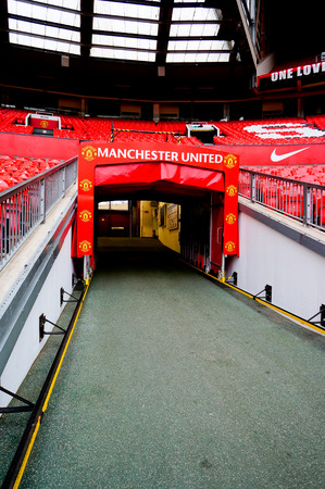 MANCHESTER ENGLAND  FEBRUARY 17: Tunnel in Old Trafford stadium on February 17 2014 in Manchester England. Old Trafford stadium is home to Manchester United.