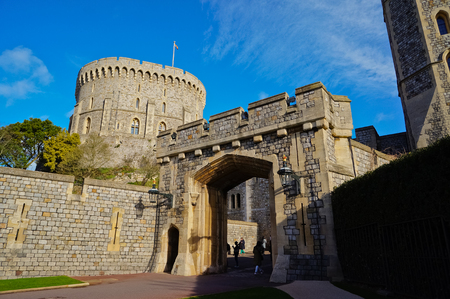 windsor: WINDSOR, ENGLAND - FEBRUARY 15, 2014: Outside view of Windsor Castle. Windsor Castle is an official residence of The Queen and the largest occupied castle in the world.