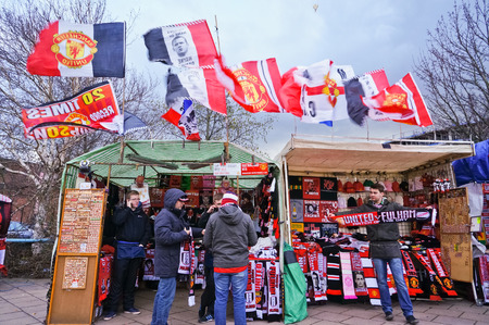 premiership: MANCHESTER, UK - FEBRUARY 9: Match day souvenir on sale in front of Old Trafford stadium on February 9, 2014 in Manchester, UK.