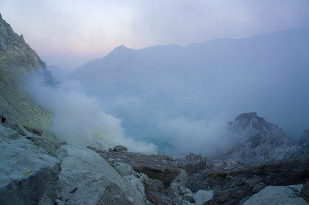 acidic: Ijen volcano in East Java contains the worlds largest acidic volcanic crater lake, called Kawah Ijen, spewing out sulphur smoke in the morning