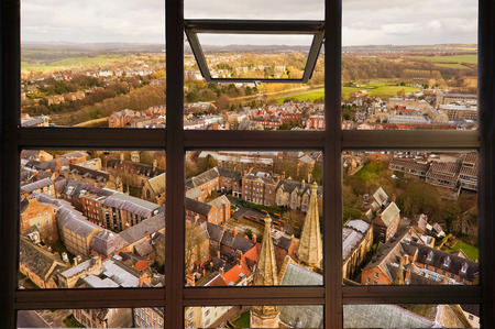 durham: Open window to see top view of Durham city. This picture was taken on Durham tower which is a part of Durham Cathedral, England. Stock Photo