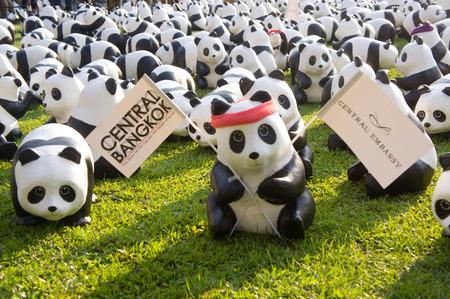 wildlife conservation: BANGKOK, THAILAND - MARCH 14, 2016: Panda flashmob at Lumpini park, 1600 paper mache pandas to raise awareness about wildlife conservation and sustainability.