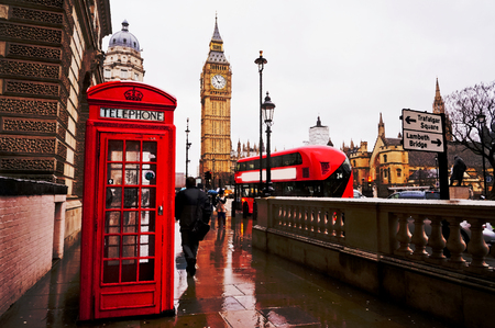 phonebooth: Traditional red telephone box after raining with the Big Ben and red bus in the background. Artistic water colour filter - Palette Knife