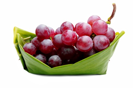 green boat: Red grapes on green boat  Stock Photo